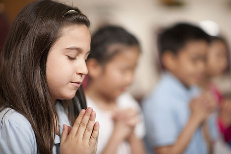 Little girl praying in church