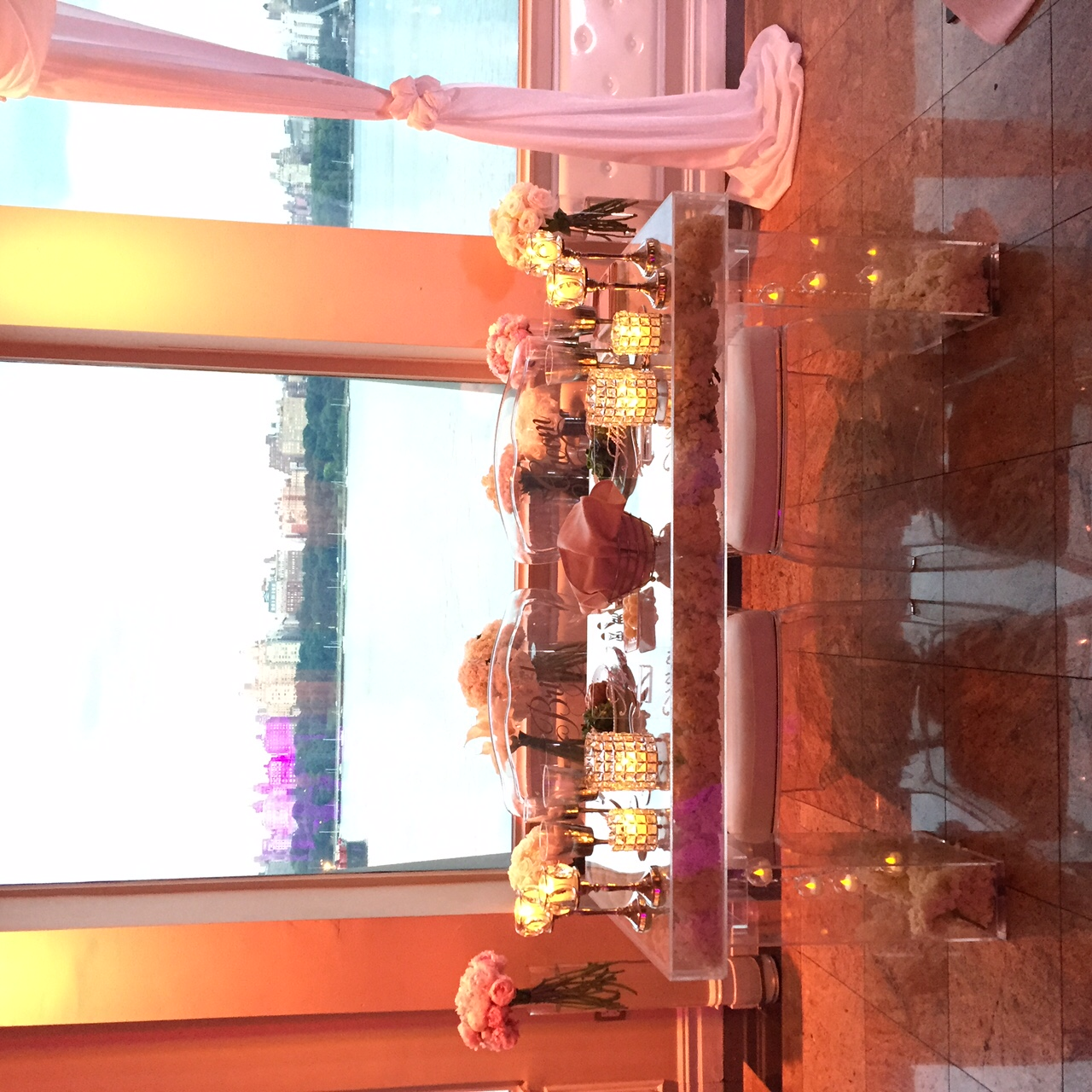 Bridal table-lucite-acrylic-fully decorated-waterside restaurant sunset