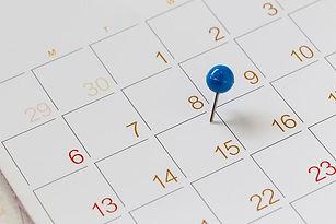 close-up-of-thumbtack-on-calendar-date-1