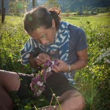 Our Artist in Residence weaving a beautiful flower lei