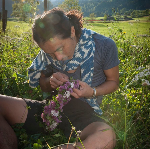 Our Artist in Residence weaving a beautiful flower lei