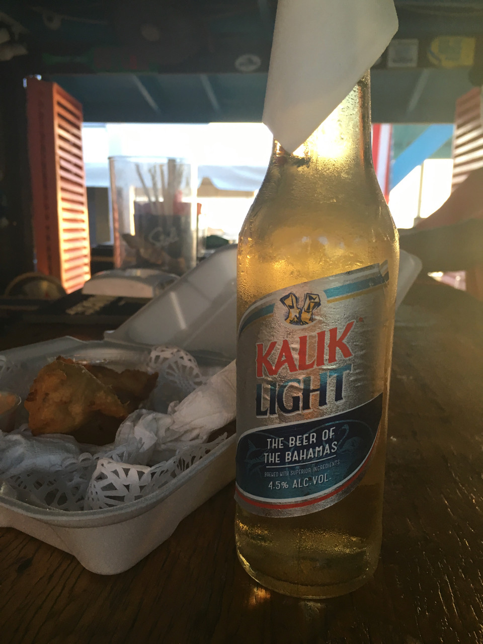 Ice cold Kalik & Conch Fritters, who needs power? No better way to watch a Harbour Island sunset