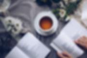 white-ceramic-teacup-with-saucer-near-tw