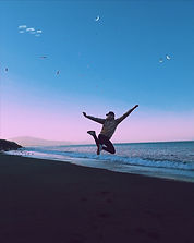 man-jumping-during-sunset-on-a-beach-204