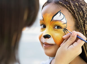 Children face painting. Artist painting