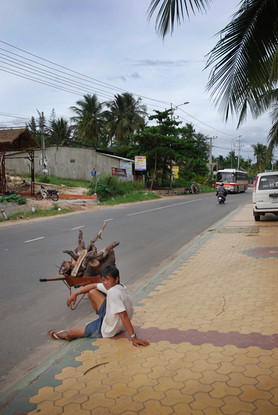 Local Vietnamese resting on the side of the road