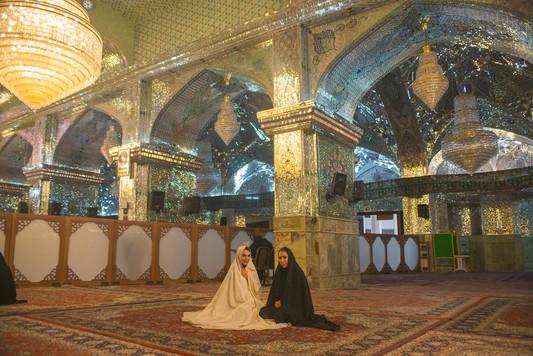 Sisters wearing religious covers inside Shah-e-Cheragh Shrine