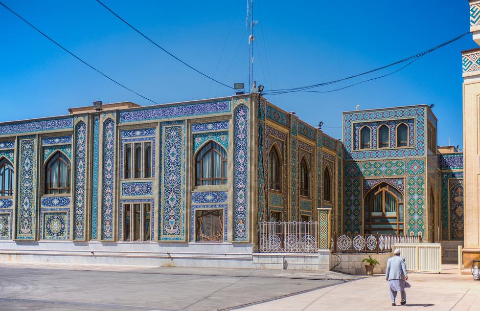 Lonely man walking away from Shah-e-Cheragh Shrine