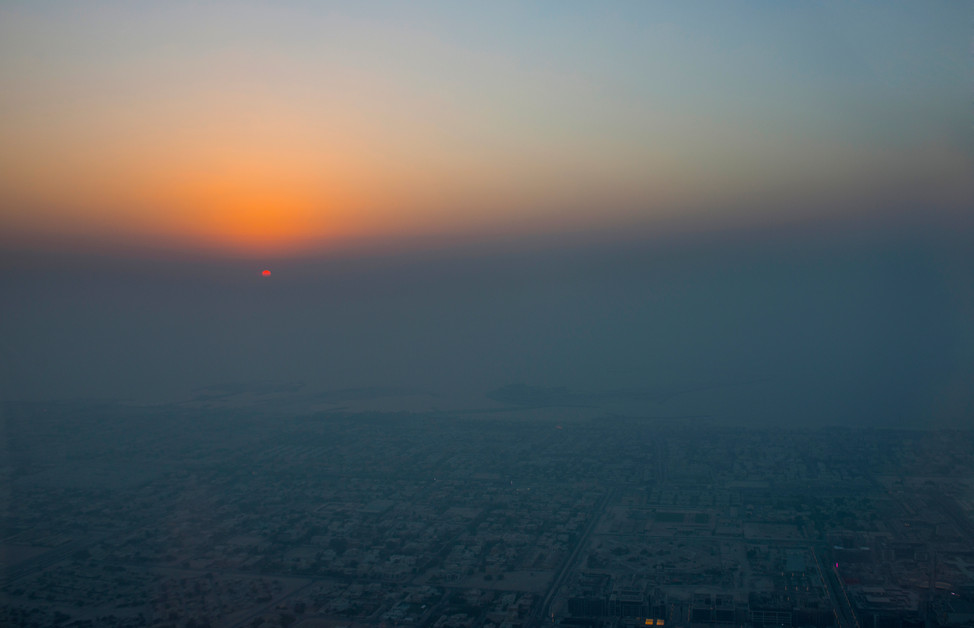 Foggy sunset. View of he City from Burj Khalifa