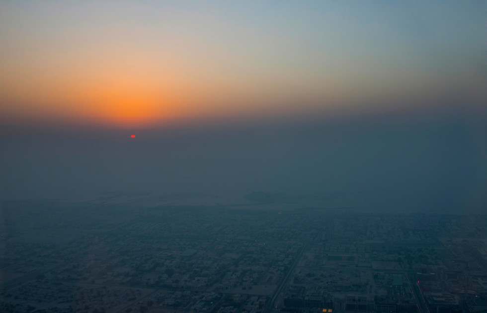 Foggy sunset. View of he City from Burj Khalifa