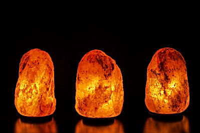 Three salt lamps on black background.jpg