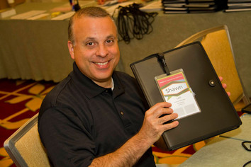 Mark packing folders for attendees at the hampton event