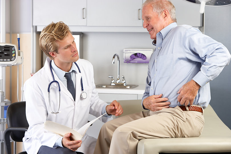 Doctor Examining Male Patient With Hip Pain.jpg