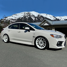 white-subaru-in-the-mountains.png
