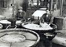 women mixing the devils porridge.jpg