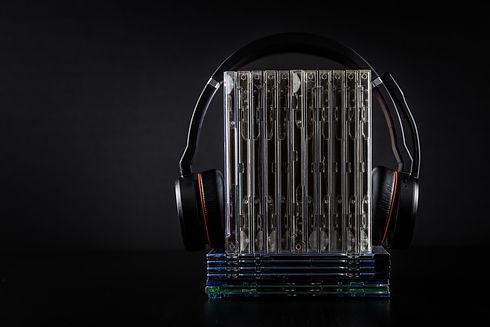 hi-fi-headphones-on-stack-of-cds-on-blac