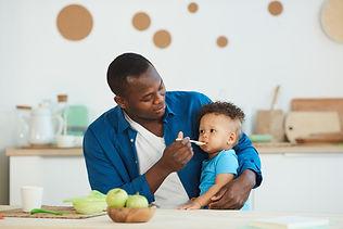 man-feeding-son-UMK9V63.jpg
