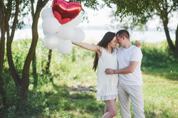 happy-and-young-pregnant-couple-hugging-