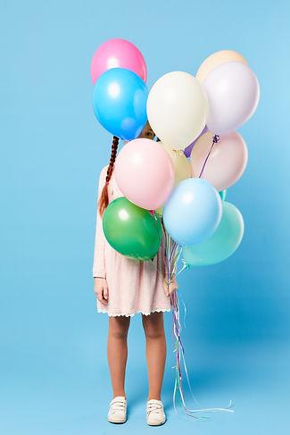 teenage-girl-holding-balloons-B5EZ6T4.jp