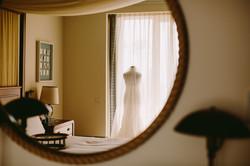 luxury-wedding-dress-hang-up-indoors-hot