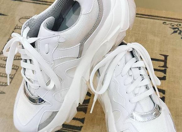 Sneakers con suola alta