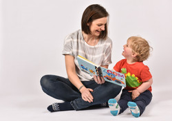 Mum and son reading book