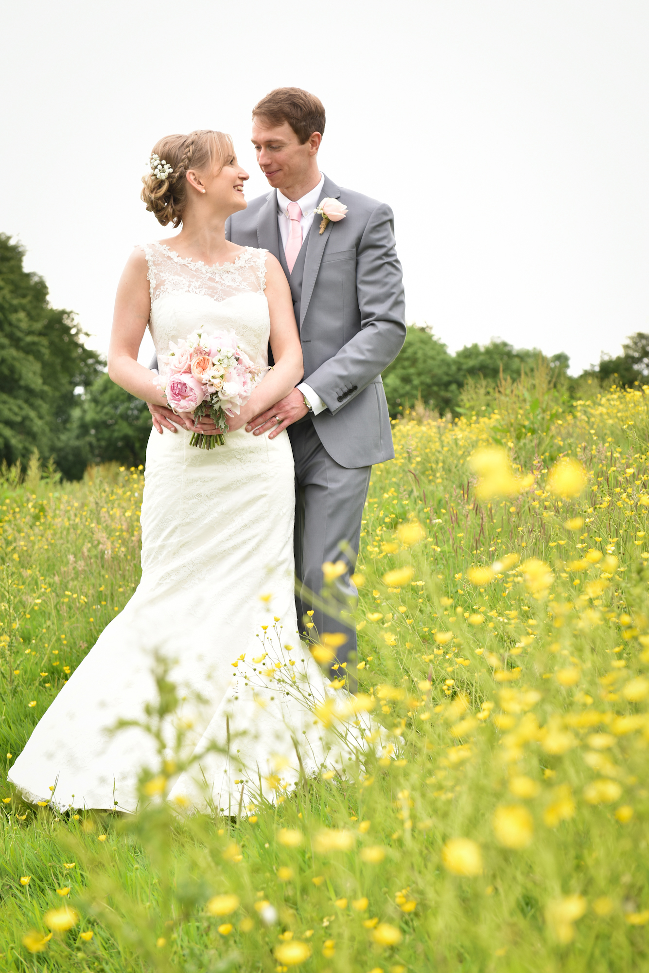 Wedding portrait in a field