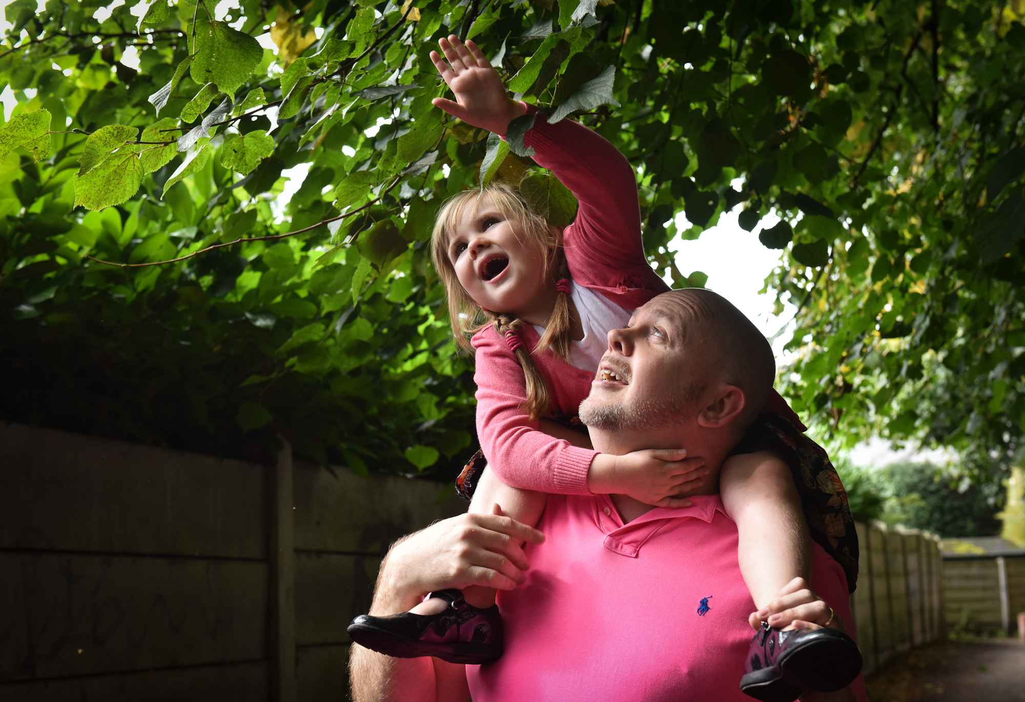 Dad and daughter portrait under tree