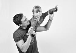 Girl on dads shoulders