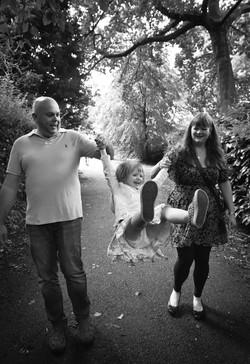 Fun family portrait in a park