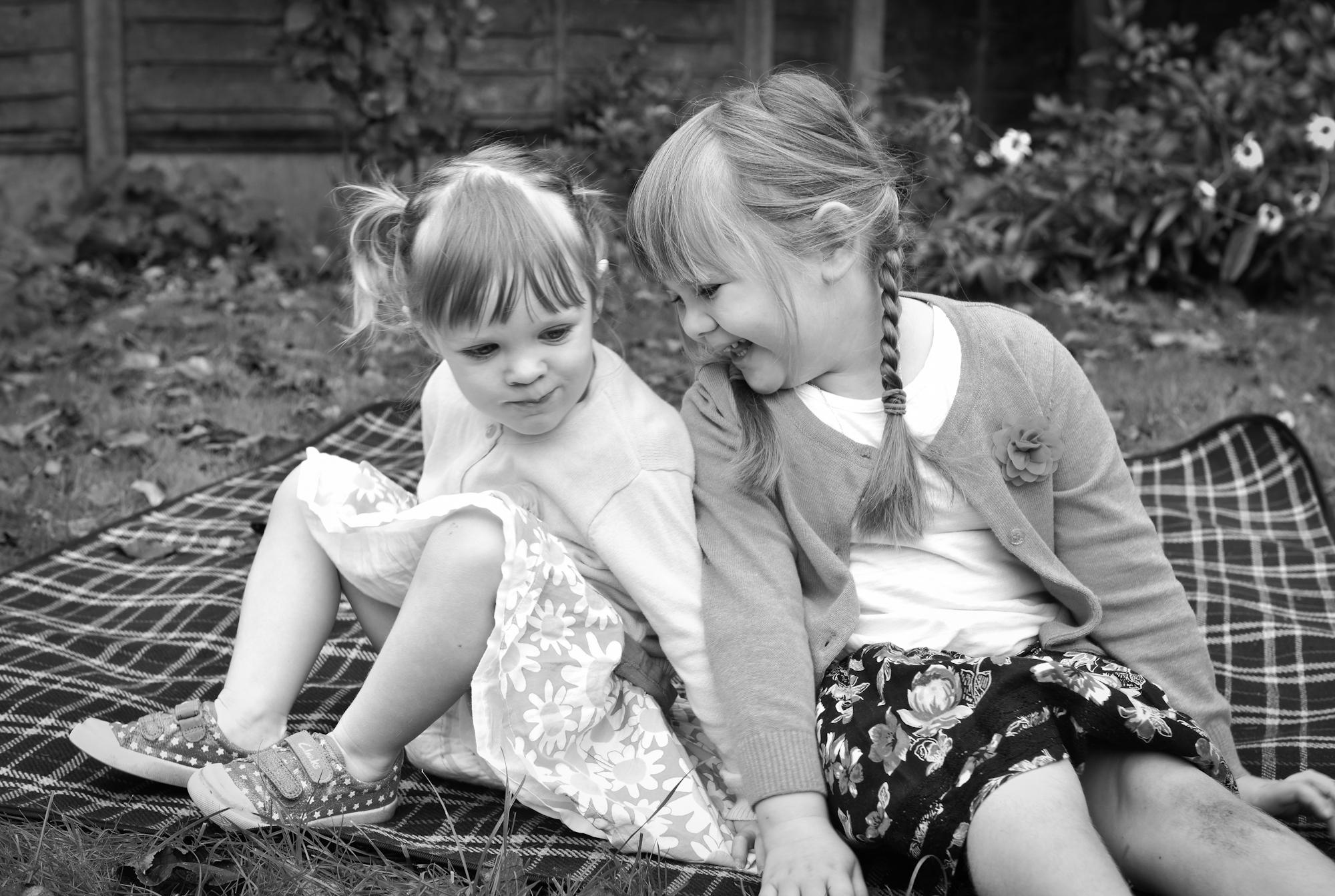Siblings picnic portrait