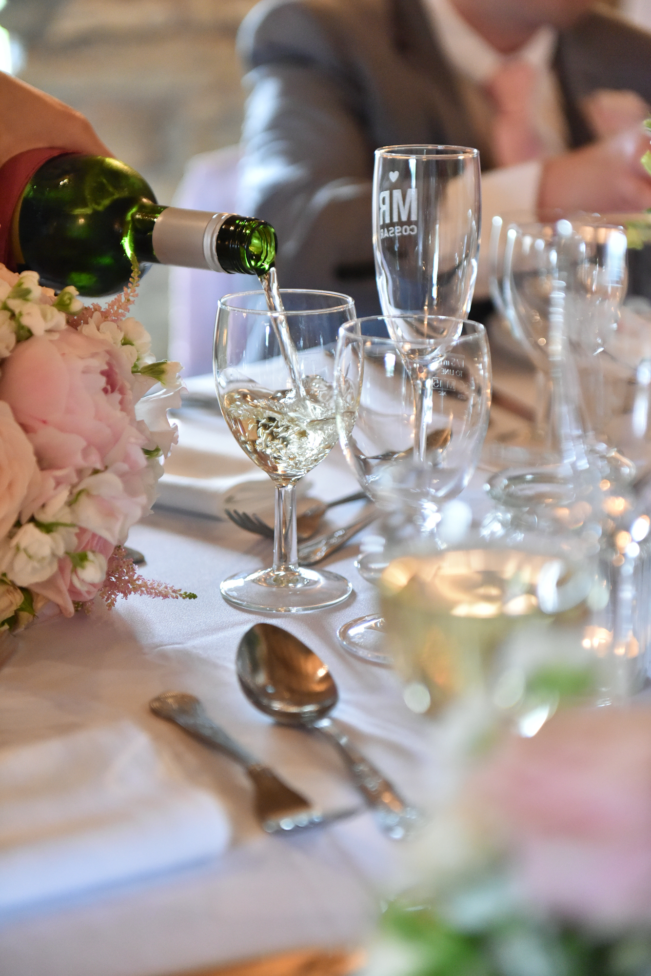 Wine pouring at wedding table