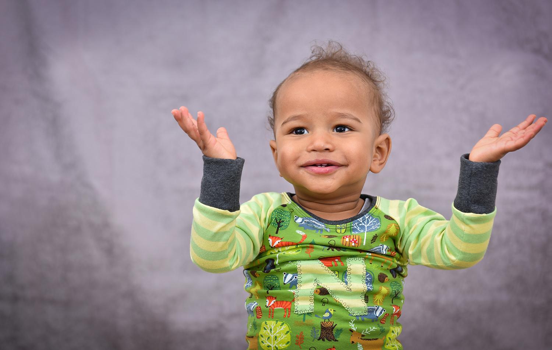 Little boy hands up