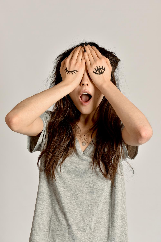model covering eyes