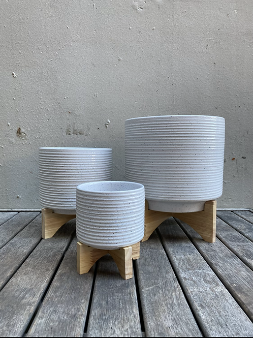 White Ribbed Ceramic Pot on Wooden Stand