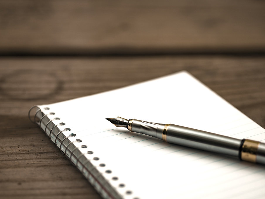 Fountain pen and a notebook_edited.jpg