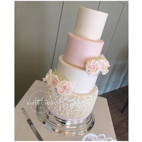 This Hidden Back Wedding Cake with hand