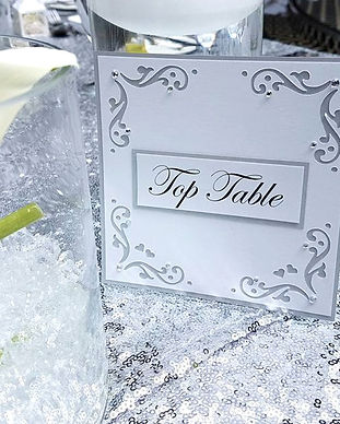 White and silver fourish wedding table name card