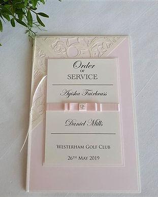 Laser cut wedding order of service pale pink