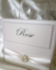Classic table name with ribbon and pearl jewel