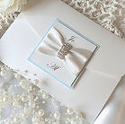 Classic pocketfold wedding invitation with ivory ribbon and diamante bar