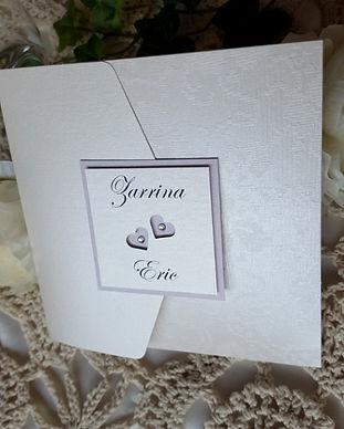 Confetti cut hearts pocketfold wedding invitation