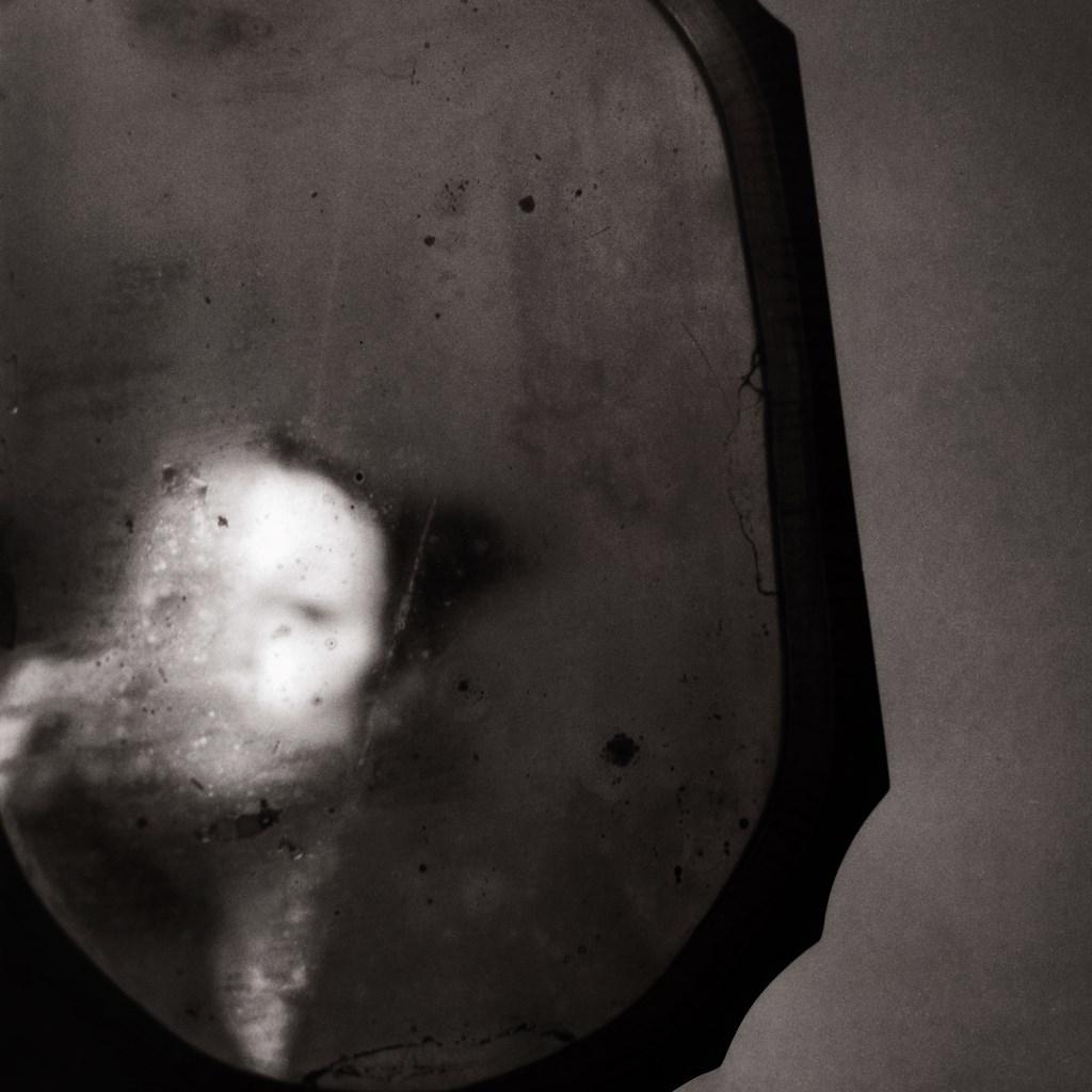 Through a broken mirror