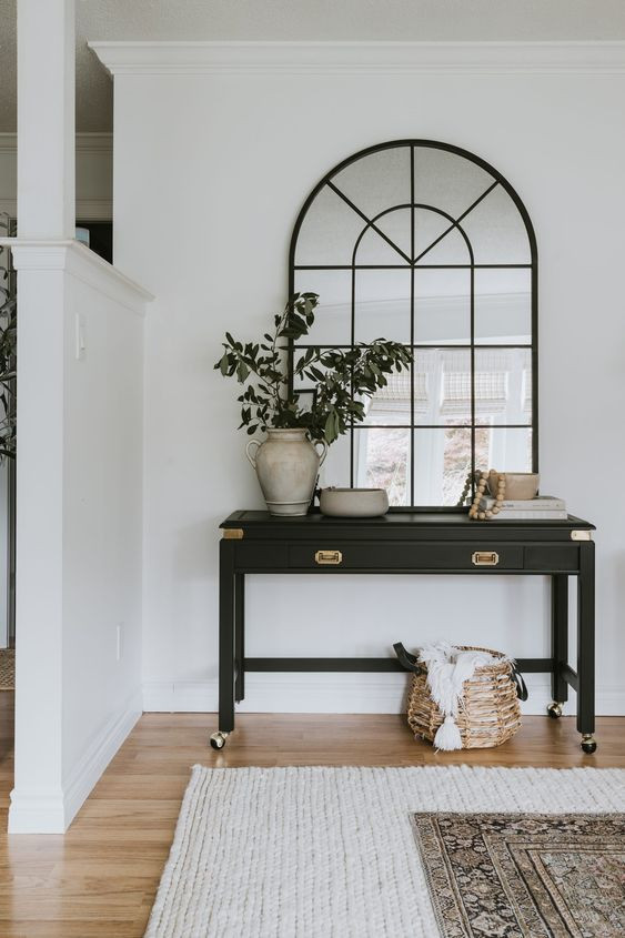 large black framed mirror and black console table