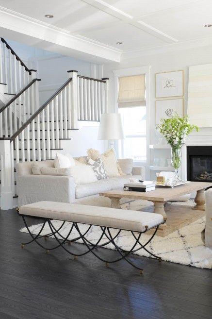 dark floors with light rug and light furnishings
