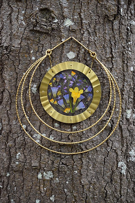 brass and flower wall hanging