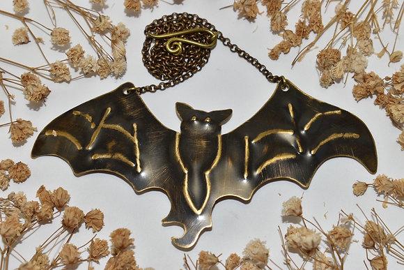 brass bat necklace