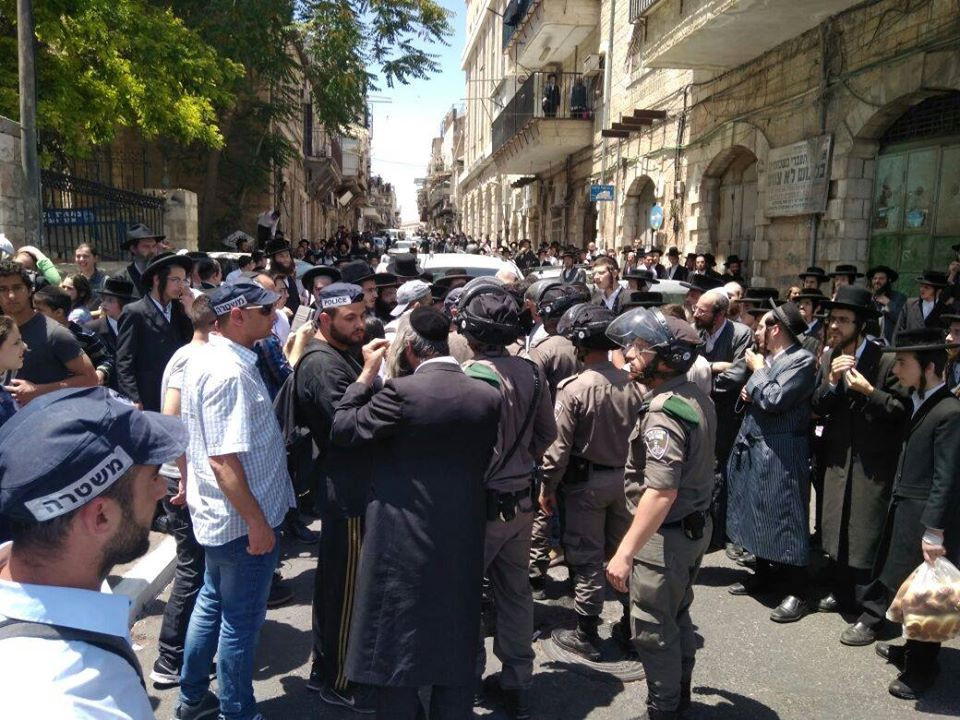 Protesting the entry of religious solders in the anti-Zionist Orthodox Jerusalem neighborhood of Meah Shearim