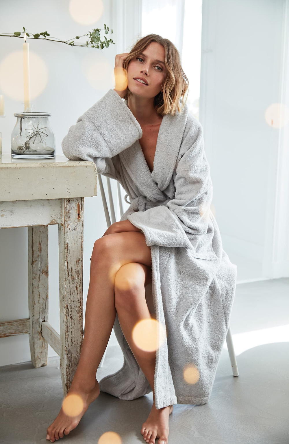 Most comfortable robe, luxurious robe, women's robes, robes, cashmere robes, woman in blue robe, blond woman in blue robe, mothers day gift, woman sitting.