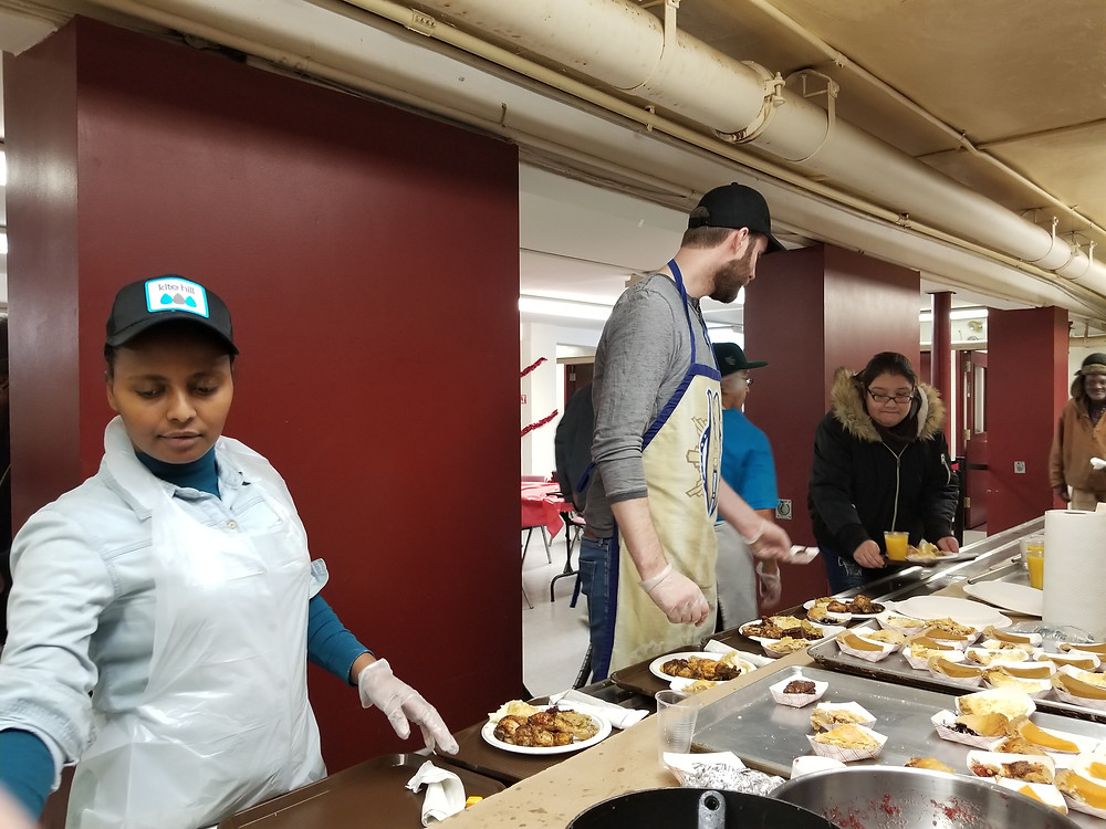 Serving a hot meal to homeless and undeserved community in NYC.
